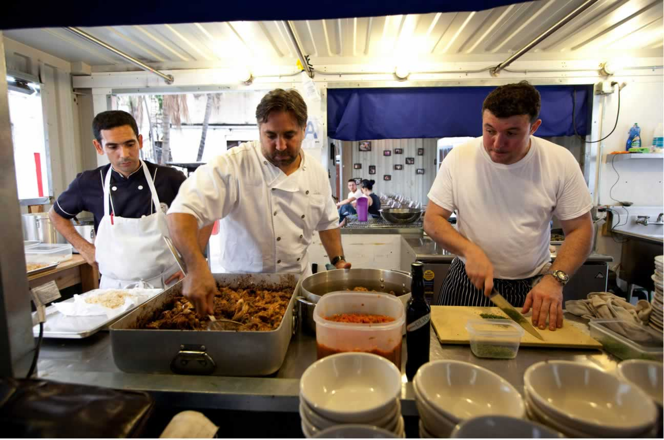 Dayron Avila, left, a Cuban chef, with Mr. Canora and Mr. Valle. Credit Jose Goitia for The New York Times